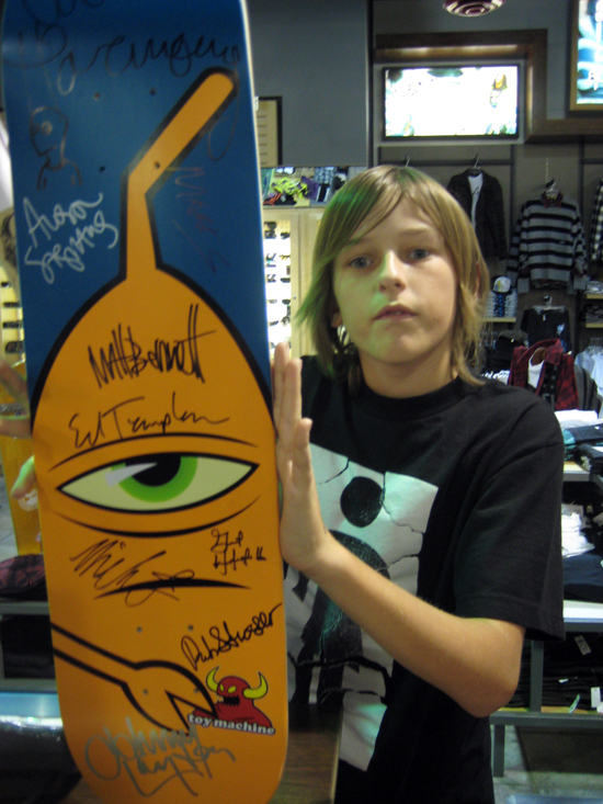 kid with signed board.jpg